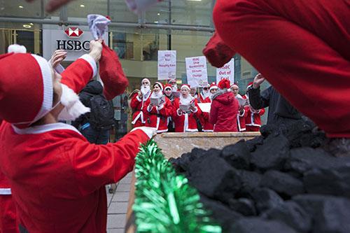Santas deliver coal to 'naughty bank' HSBC - London Mining